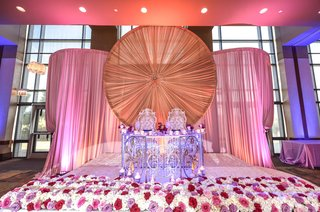 elaborate-sweetheart-table-at-indian-wedding-drapery-red-rose-bed