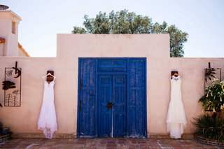 mermaid-wedding-gowns-hang-in-front-of-ranch-venue