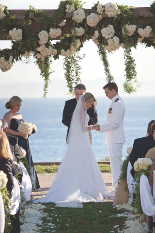 bride-and-groom-in-white-dress-uniform-for-navy-wedding