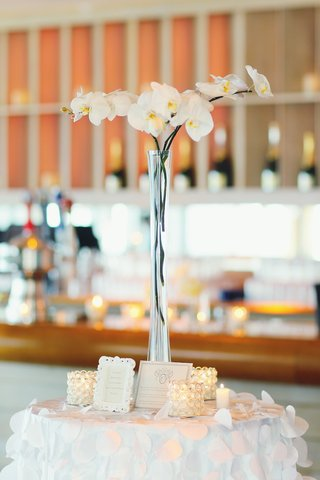 cocktail-table-with-white-linen-and-orchid-centerpiece