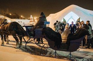 ice-castle-wedding-ceremony-unique-venue-horse-drawn-carriage-winter-wedding-ideas