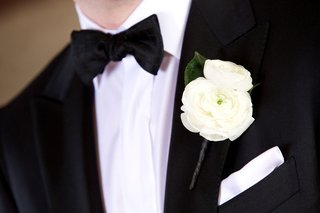 grooms-black-and-white-tuxedo-with-two-fresh-ranunculus-blooms-and-white-pocket-square