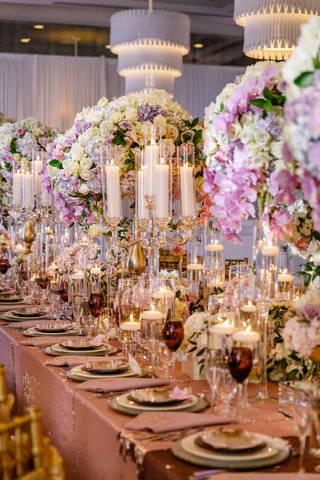 wedding-reception-shimmer-linen-floating-candles-colored-glassware-candelabra-crystal-tall-flowers