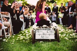 bridesmaid-pulling-little-ring-bearer-bride-son-in-wagon-with-here-comes-my-mommy-sign-wedding-ideas