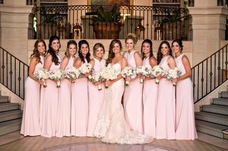 bride-in-ines-di-santo-wedding-dress-with-bridesmaids-in-pink-bridesmaid-dresses-bouquets