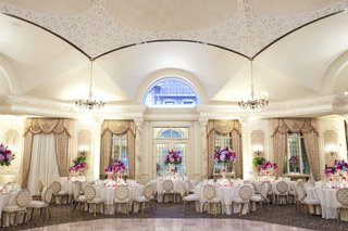 wedding-reception-with-purple-pink-centerpieces-at-the-grand-ballroom-of-the-pleasantdale-chateau