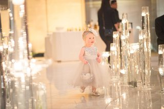 little-girl-walking-by-floating-candles-in-silver-shoes