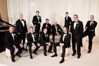 wedding-ceremony-chicago-groom-and-groomsmen-tuxedo-attire-black-tie-white-gold-lounge-furniture