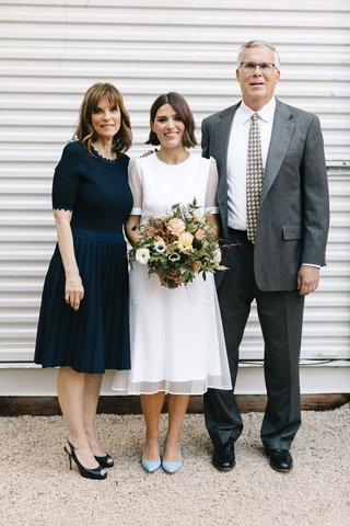 bride-in-short-sleeve-givenchy-wedding-dress-short-hair-down-fall-bouquet-mother-in-navy-blue-dress