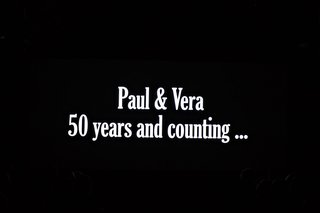 wedding-video-montage-for-guests-paul-and-vera-fifty-years-and-counting-black-and-white-text