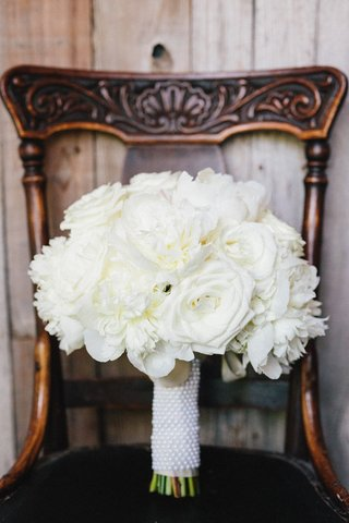 bridal-bouquet-white-roses-and-peonies-tied-with-white-ribbon