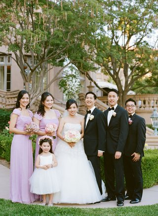 bridal-party-of-newlyweds-flower-girl-two-groomsmen-and-two-bridesmaids-in-purple