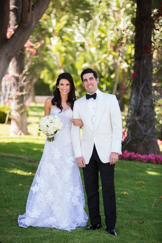 morgan-rosen-in-a-line-mira-zwillinger-wedding-dress-and-groom-in-tuxedo-white-jacket-black-bow-tie