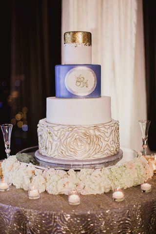 white-wedding-cake-blue-layer-gold-layer-with-gold-tip-rosette-texture-on-bottom-tier