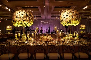 purple-lighting-at-live-band-wedding-reception-stage-with-long-kings-table-high-centerpieces-candle