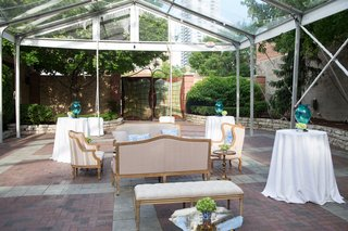 outdoor-tented-setting-beige-seating-southern-inspired-wedding