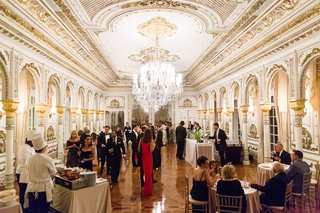 wedding-reception-mar-a-lago-club-white-and-gold-ballroom-chandelier-hors-doeuvres-and-appetizers
