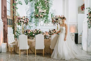 jinza-couture-bridal-gown-katie-in-front-of-modern-garden-table-wedding