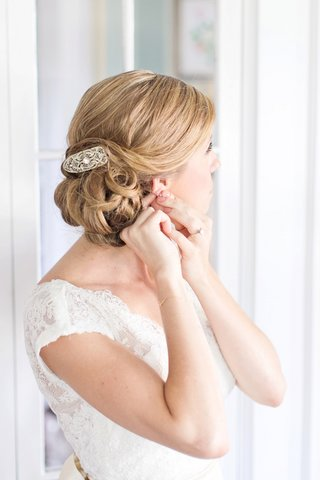 bride-in-an-alencon-lace-watters-gown-with-cap-sleeves-updo-and-hair-clip-with-rhinestones