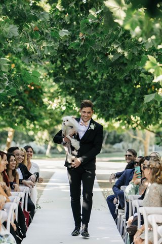 jillian-murray-and-dean-geyer-wedding-ceremony-groomsman-carrying-chinese-crested-dog
