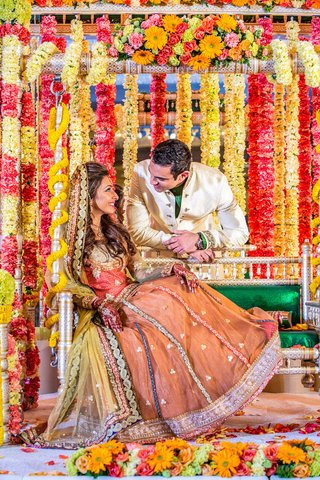 indian-bride-and-groom-amid-vibrant-flower-garlands