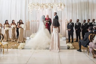 wedding-ceremony-white-flooring-gold-chairs-lucite-acrylic-arch-arbor-with-white-rose-orchid-flowers