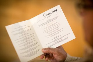 a-guest-reads-a-ceremony-program