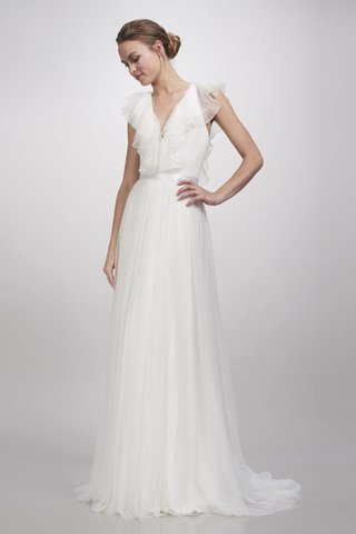 gown-with-deep-v-neckline-frill-detailing-on-the-sleeves-a-thin-belt-and-a-tulle-skirt-by-theia