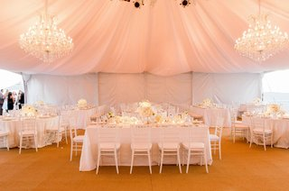 beach-tented-wedding-reception-with-crystal-chandeliers-white-linens-chairs-flowers-burnt-orange