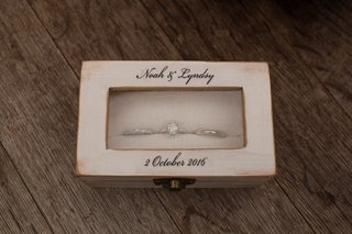 wood-jewelry-box-with-wedding-rings-for-lyndsy-fonseca-and-noah-bean