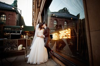 bride-in-essence-of-australia-wedding-dress-groom-in-bonobos-tux-kiss-leaning-against-window