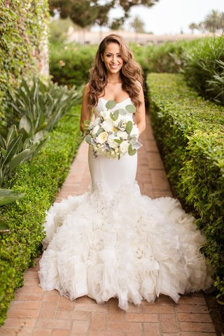bride-in-ines-di-santo-mermaid-wedding-dress-with-ruffles-glam-side-part-hair-with-waves