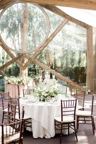 calamigos-ranch-oak-room-wedding-crystal-candelabra-with-floral-arrangement