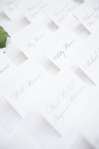 classic-white-escort-cards-with-silver-calligraphy