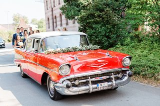 wedding-getaway-car-transportation-to-ceremony-red-chevy-chevrolet-classic-car