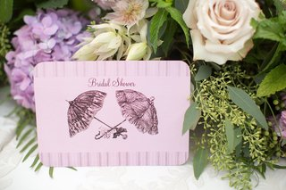 pink-bridal-shower-invitation-with-parasol-umbrella-sketch-motif-on-front