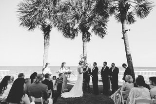 black-and-white-photo-of-grass-aisle-wedding-ceremony-overlooking-ocean-palm-trees-island-wedding