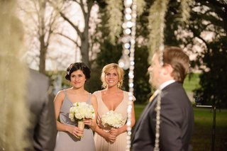 bridesmaids-holding-white-bouquets-in-grey-and-tan-dresses