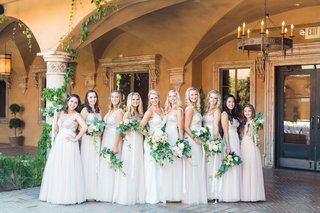 bride-with-bridesmaids-ivory-and-blush-mismatched-dresses-junior-bridesmaid-greenery-bouquets-villa