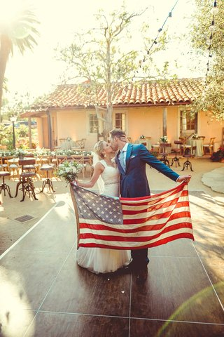 jenna-reeves-and-tim-lopez-hold-american-flag-on-dance-floor-of-their-santa-barbara-wedding-4th