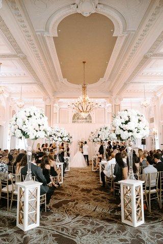 ballroom-wedding-ceremony-georgian-ballrooms-white-pink-flower-arrangements-gold-chairs-chandelier