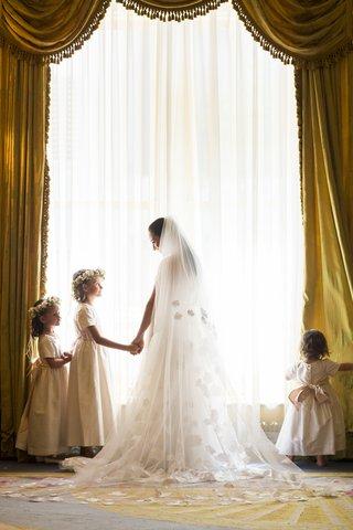 bride-holding-flower-girls-hand-with-flower-crown