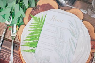 rustic-table-setting-celtic-dinner-menu-gold-green-white-wood-tree-stump-wedding