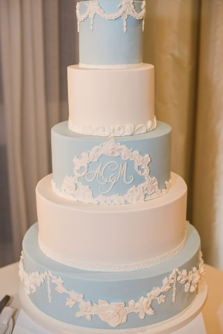 five-tier-wedding-cake-alternating-in-pale-blue-and-white-molded-floral-accents-monogram