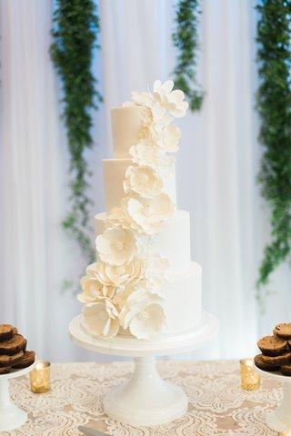 four-tier-white-wedding-cake-with-white-sugar-flowers