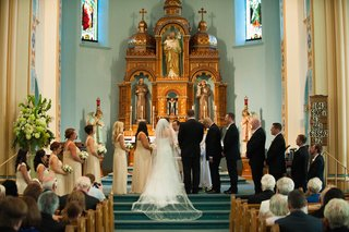 bride-and-groom-with-wedding-party-on-steps-of-altar