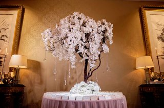 wedding-reception-escort-card-table-pink-linen-tall-orchid-tree-crystal-strands-branches