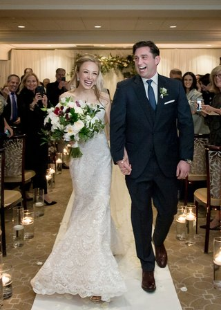 walking-down-the-aisle-at-their-winter-wedding-at-a-connecticut-country-club