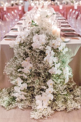 wedding-reception-floral-runner-with-babys-breath-and-orchids-neutral-linens