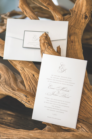 large-white-envelope-with-rectangular-seal-and-invite